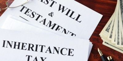 Inheritance tax form on a table and cash.